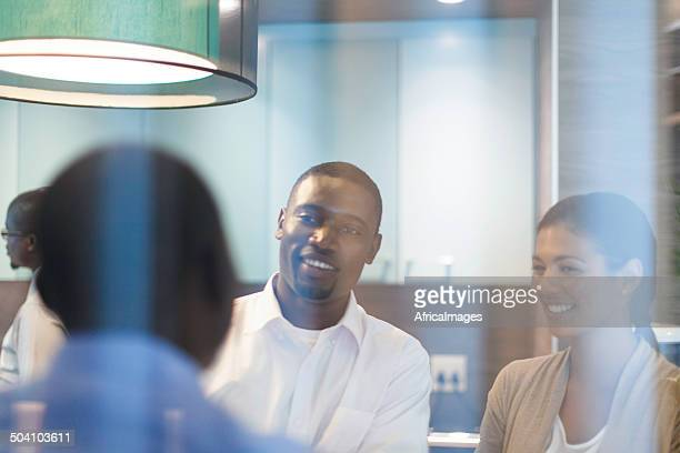 African business colleagues having a conversation in the kitchen.
