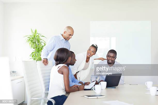 African business colleagues having a discussion in the boardroom