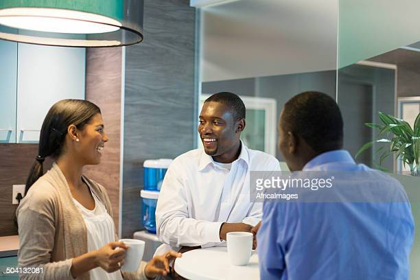 African business colleagues having coffee together.