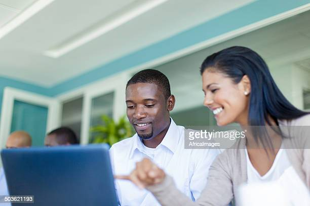 African business colleagues viewing presentations on the laptop