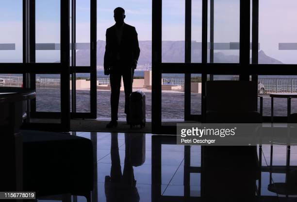 african business man checking in to a hotel. - table mountain stock pictures, royalty-free photos & images
