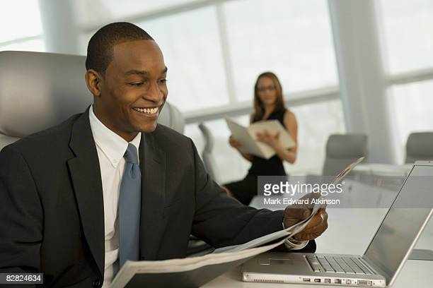 African business man reading newspaper