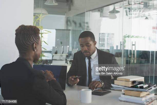 african business people discussing at the office - nigerian men stock photos and pictures