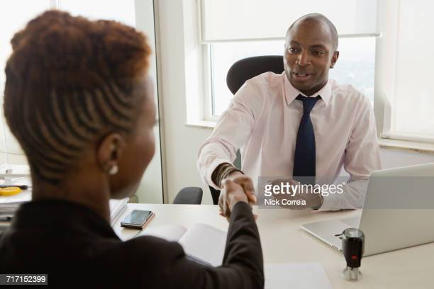 African business people shaking hands at the office