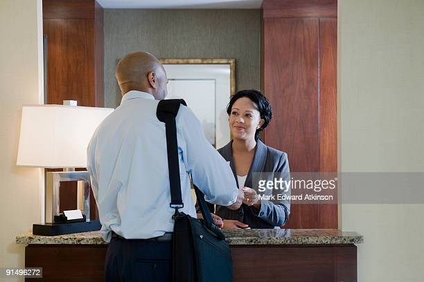 African businessman at hotel check-in