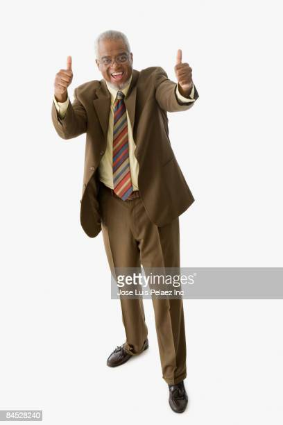 African businessman giving the thumbs up sign