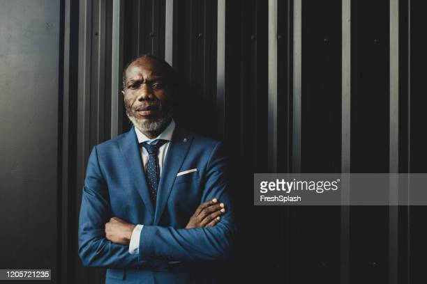 african businessman looking at camera - double breasted stock pictures, royalty-free photos & images