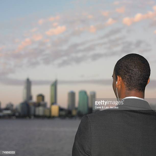 African businessman looking at city skyline