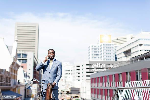 African businessman on the phone having a conversation.