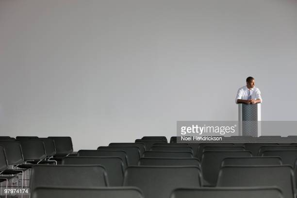 african businessman preparing for speech - zuschauerraum stock-fotos und bilder