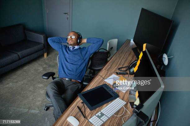 African businessman relaxing at the office