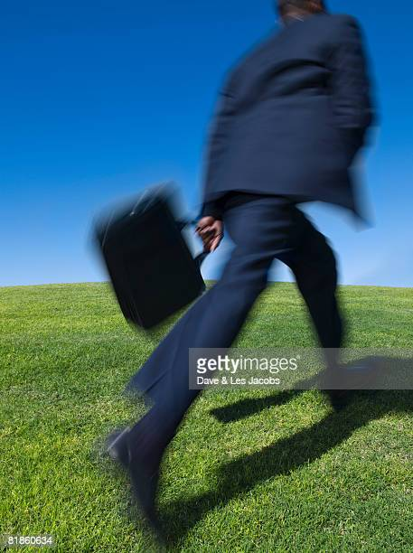 African businessman running uphill