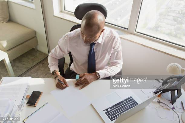 African businessman signing document at the office