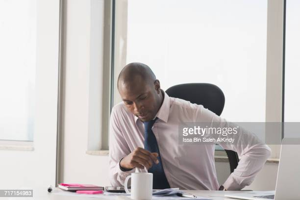 African businessman sitting at the office