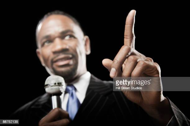 African businessman speaking with microphone