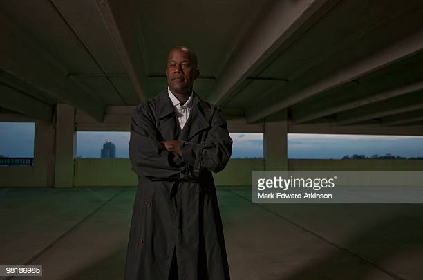 African businessman standing in parking garage
