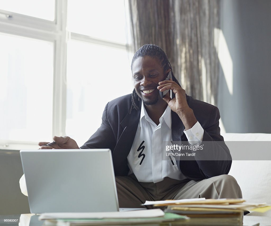 African businessman talking on cell phone : Stock Photo