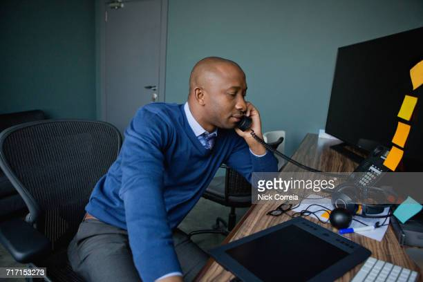 African businessman talking on telephone at the office