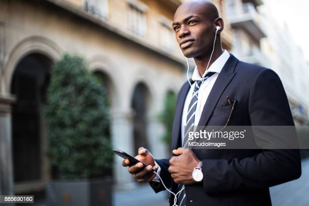 african businessman using mobile phone - nigeria stock pictures, royalty-free photos & images