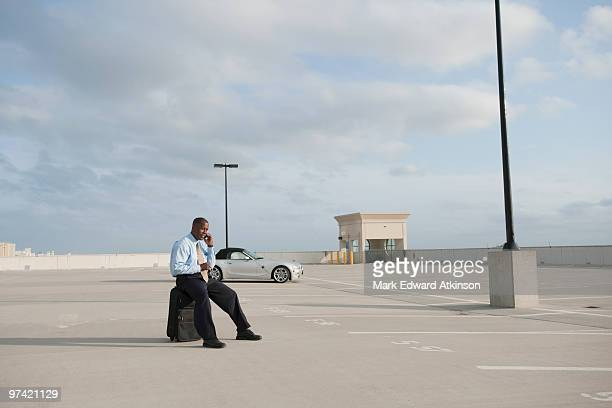 African businessman waiting in parking lot