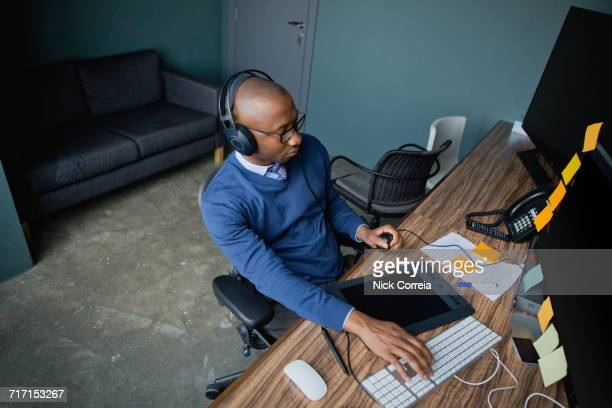 African businessman wearing headset at the office