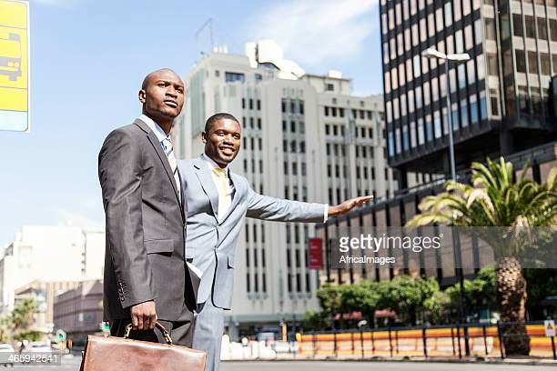 African businessmen stopping the bus