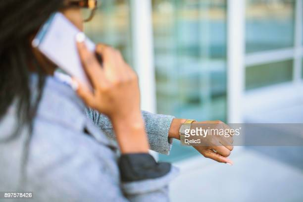 african businesswoman checking time. - unrecognisable person stock pictures, royalty-free photos & images