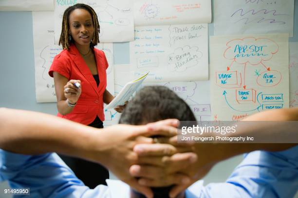 African businesswoman explaining idea to co-worker