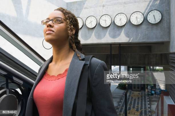 african businesswoman in train station - clocks go forward stock pictures, royalty-free photos & images