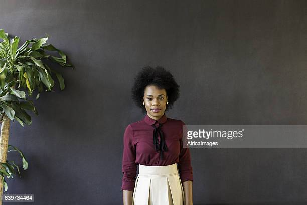 African businesswoman looking at the camera.