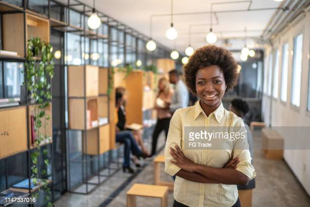 african businesswoman portrait at modern startup company - incidental people stock pictures, royalty-free photos & images