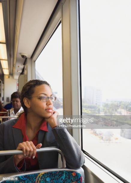 African businesswoman riding on train