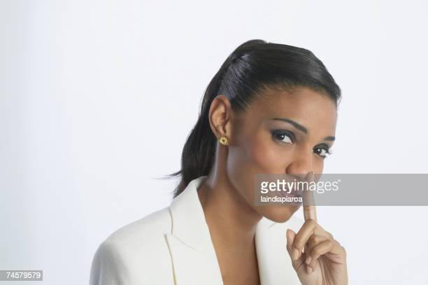 african businesswoman shushing - long nose stock photos and pictures