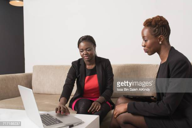 African businesswomen using laptop in office