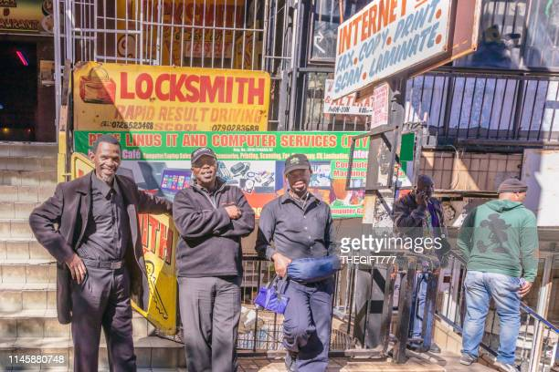 african bystanders posing in hillbrow, johannesburg - internet cafe stock pictures, royalty-free photos & images