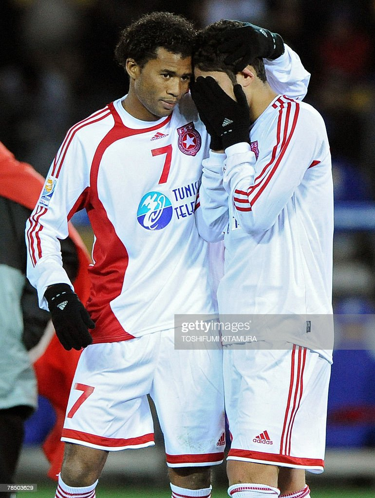 African champions Etoile Sahel midfielder Mejdi Traoui (R) is comforted by forward Gilson Silva (L) after loosing against Asian champions Urawa Reds in the Club World Cup Japan 2007 play-off match for the third place by penalty shootout in Yokohama, 16 December 2007. Urawa beat Sahel by 2-2 (4-2) to clinch the third place.