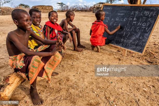 african children during english class, east africa - poor africans stock pictures, royalty-free photos & images