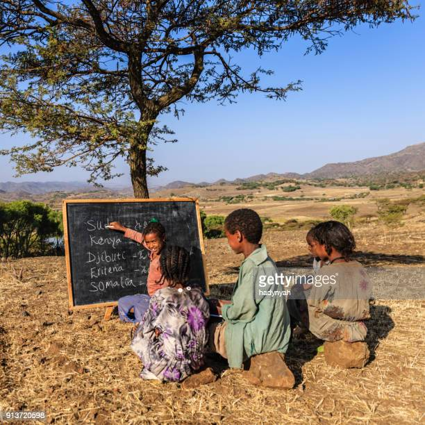 african children during english class, east africa - horn of africa stock pictures, royalty-free photos & images