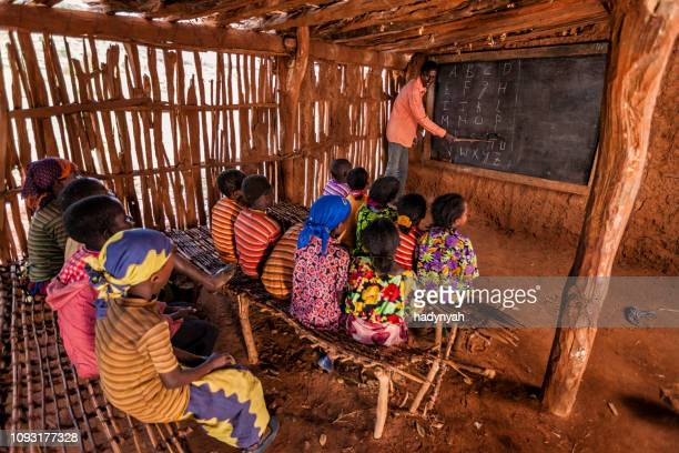 african children during english class, southern ethiopia, east africa - poor africans stock pictures, royalty-free photos & images
