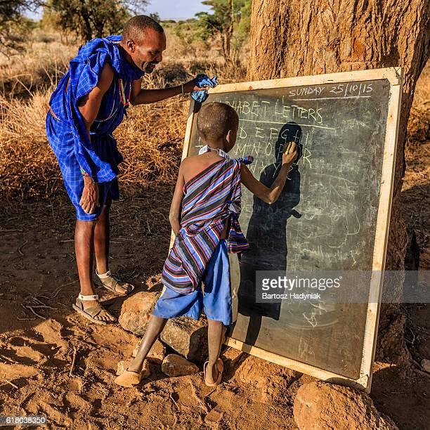 African children in the school under tree, Kenya, East Africa