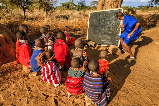 African children in the school under tree, Kenya, East Africa 637202098