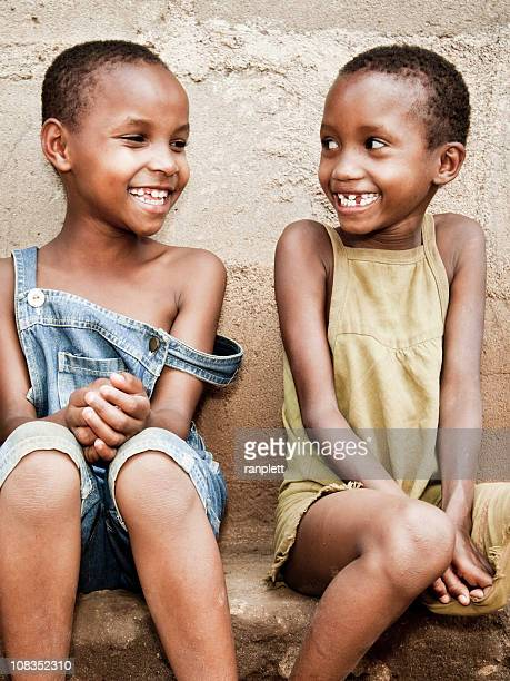 African Children Smiling with Missing Teeth