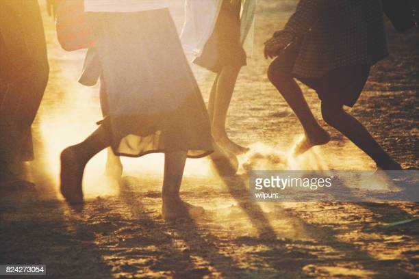 african children soccer feet at sunset - dirty feet stock pictures, royalty-free photos & images