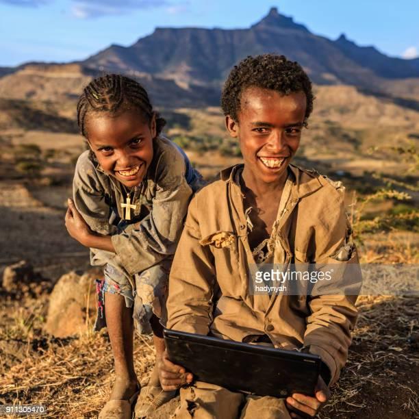 African children using digital tablet, East Africa