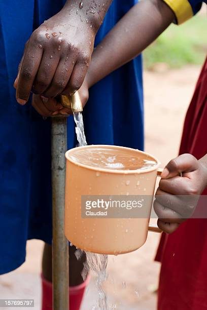 African children with cup of water