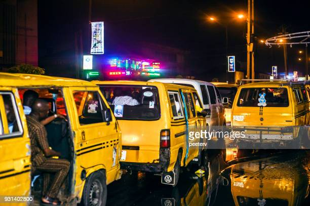 african city night traffic - lagos, nigeria - lagos nigeria stock pictures, royalty-free photos & images