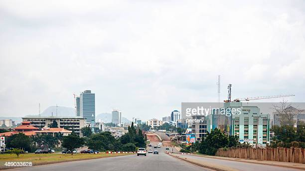 african city skyline. abuja, nigeria. - abuja stock pictures, royalty-free photos & images