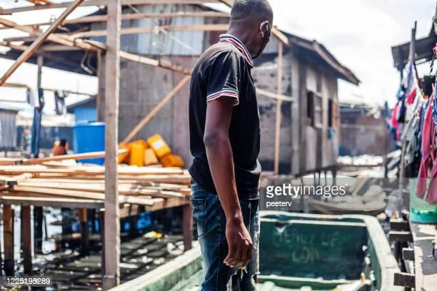 "african city slum - lagos, nigeria - ""peeter viisimaa"" or peeterv stock pictures, royalty-free photos & images"