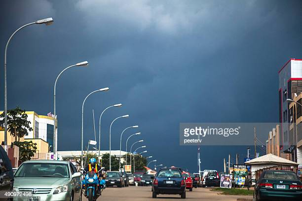 african city traffic. abuja, nigeria. - abuja stock photos and pictures