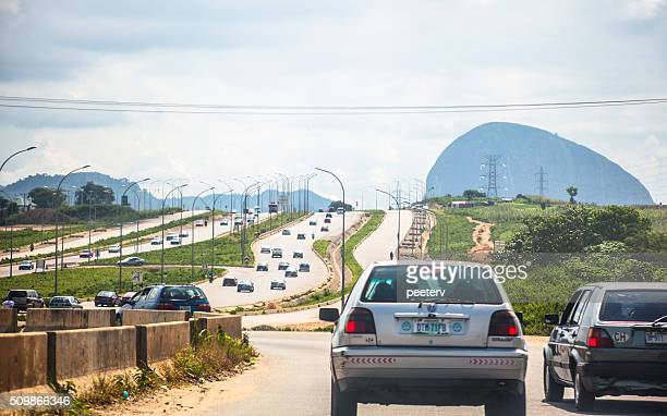 african city traffic. abuja, nigeria. - abuja stock pictures, royalty-free photos & images